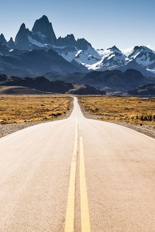 long road leading to mountains