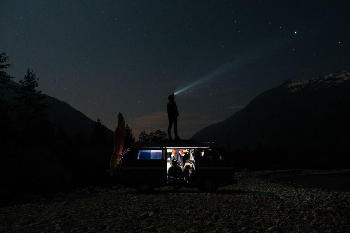 camper van in wilderness at night
