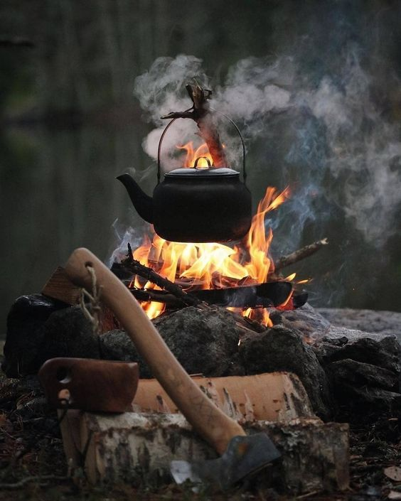 campfire with axe