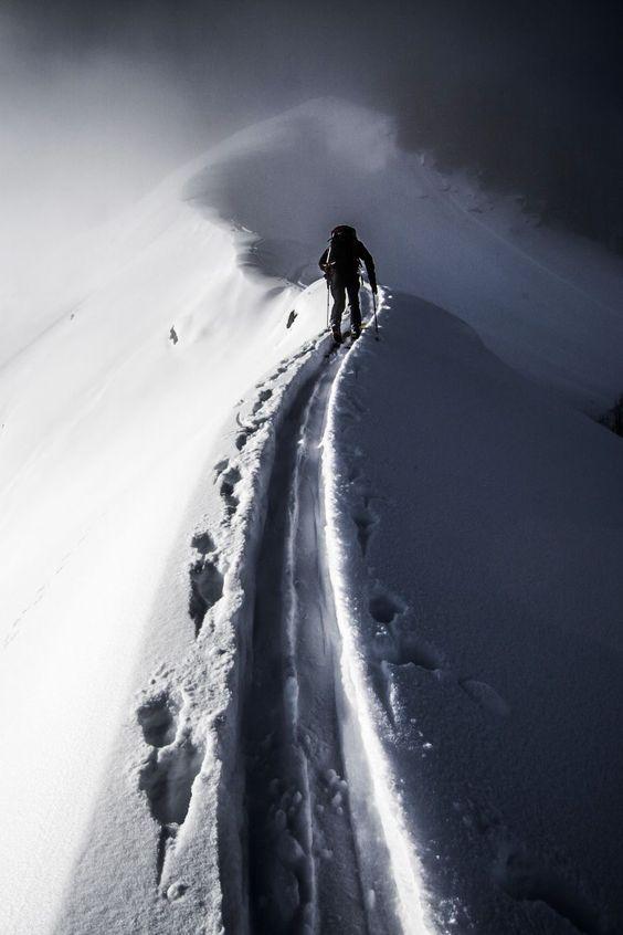 mountain climber trekking through snow