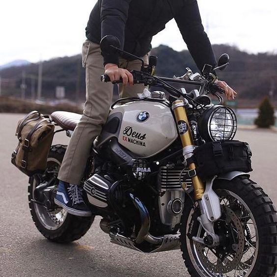 man riding bmw motorcycle