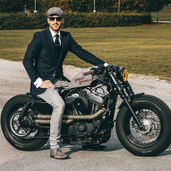 Dapper gentleman rider on Harley Davidson sportster