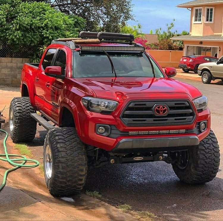 red lifted Toyota pickup