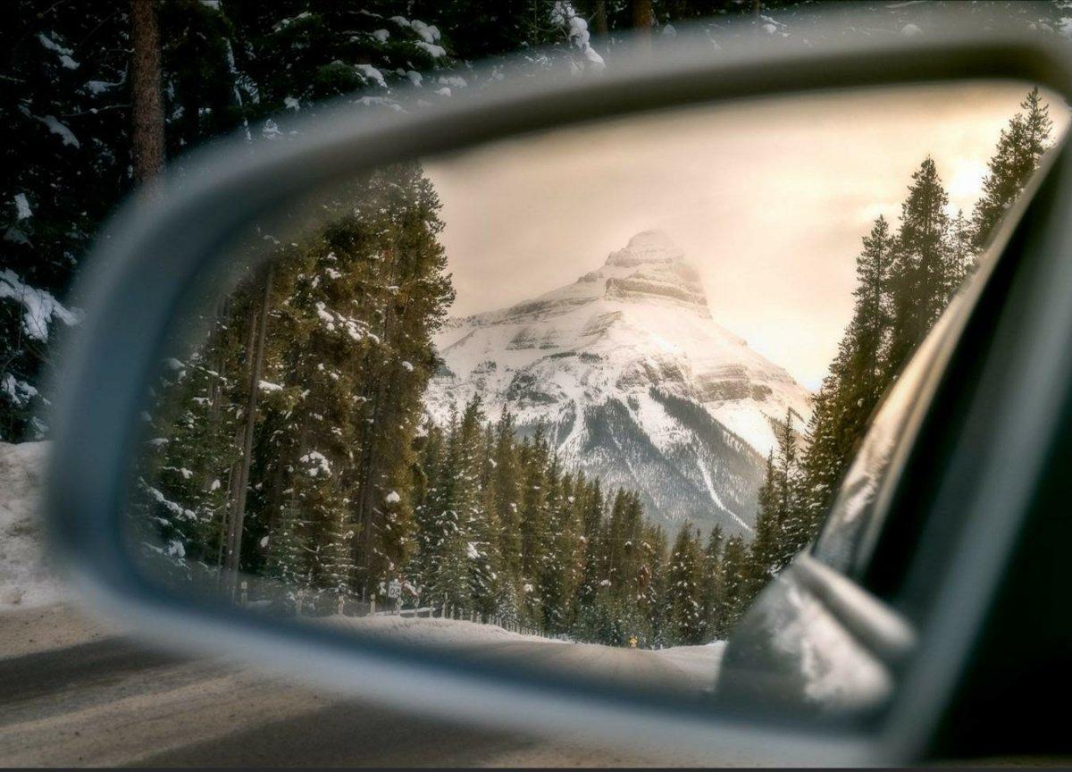 mountain scene through rear view mirror