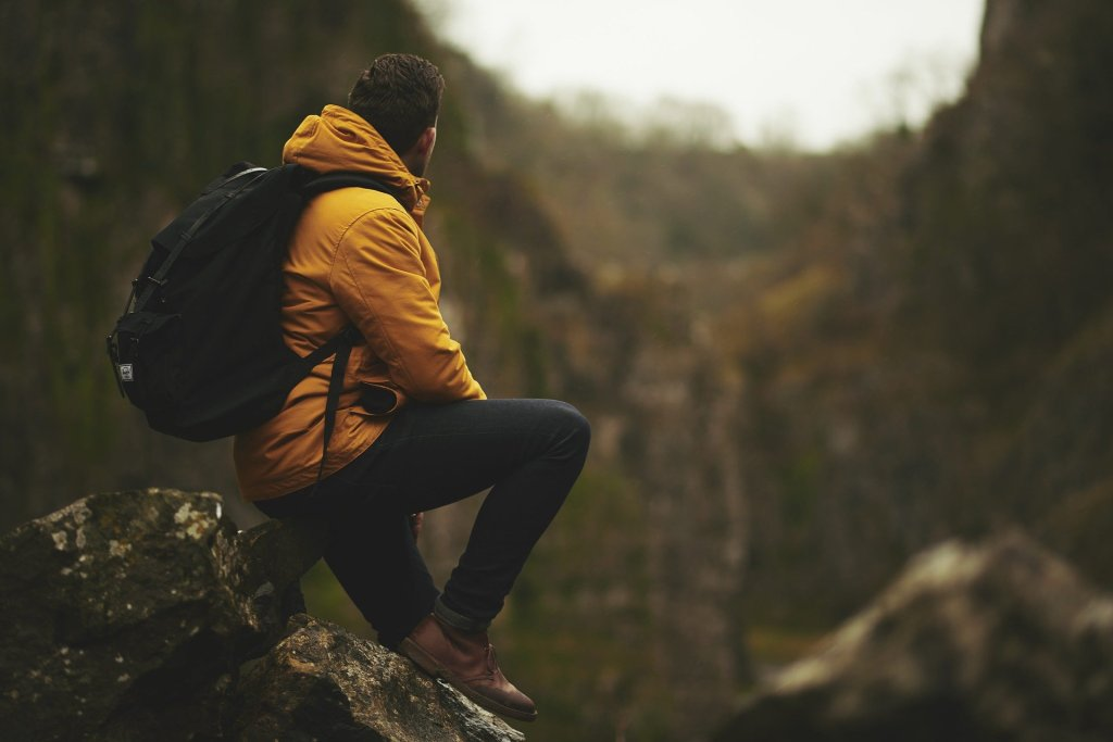 man with backpack in wilderness