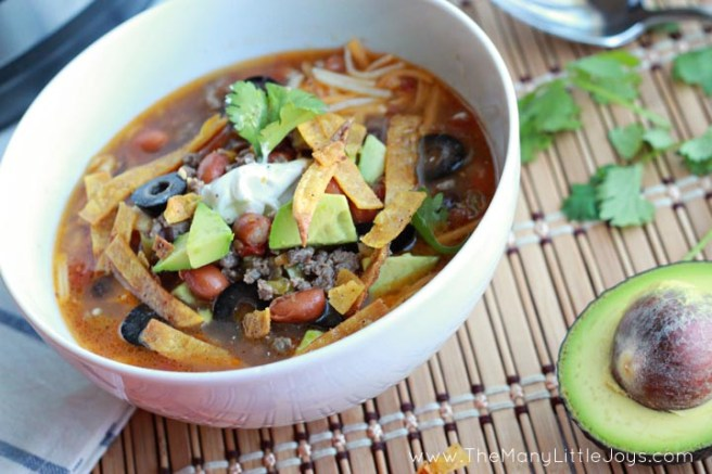 This easy taco soup recipe comes together in minutes, is inexpensive, and makes a great freezer meal. Cooked on the stove, in the slow cooker, or in your Instant Pot...it's the perfect weeknight meal.