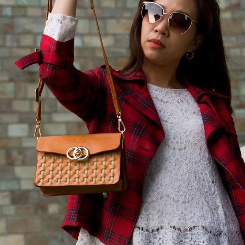mini purse brown model strap in hand