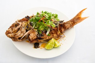Crispy whole baby snapper w hot & sour salad