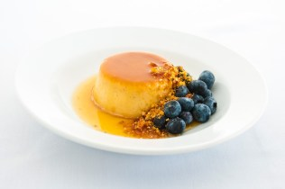 Creme caramel w fresh blueberries lemon zest & almond praline