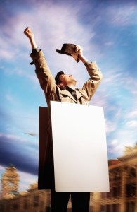 """Photo of a man wearing a blank board wondering """"what is my real USP?"""""""