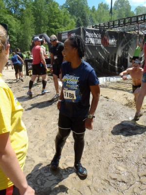 Photo of Julie at the Spartan Race, standing in the mud