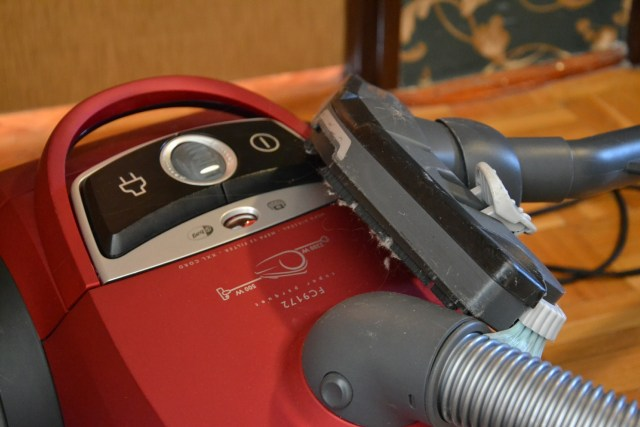 A vacuum cleaner with an upholstery attachment is guaranteed to be a big help!