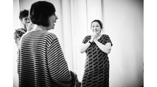 Jenny Rowe looking delighted while teaching Improv