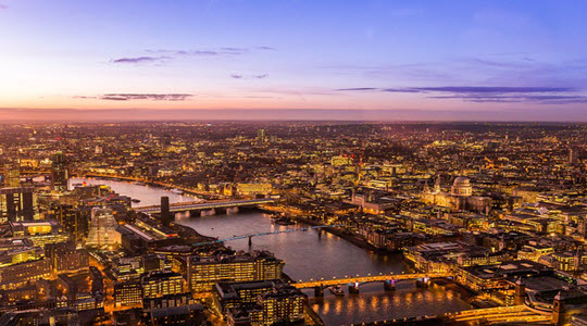 The bridges of London at dusk from the sky