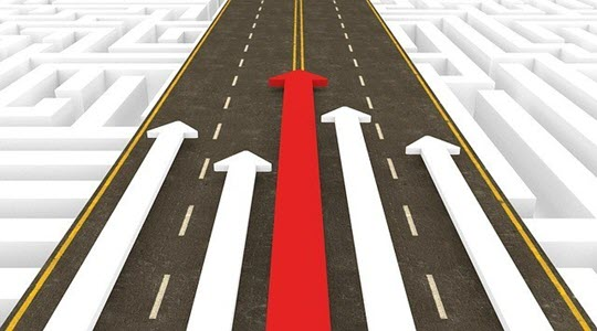 A road with white and red arrows superimposed