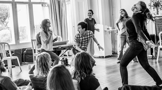 Dramatic scene taking place at The Maydays Improv Retreat Festival