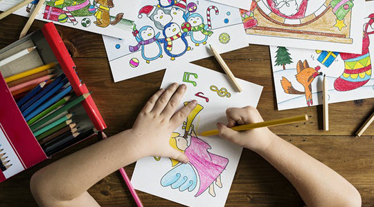 top down image of a child drawing a fairy