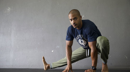 a man stretching his leg to the side
