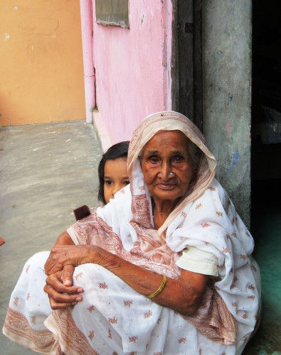 An old woman and her grand daughter rest in a safe place amid the flooded streets of Varanasi.