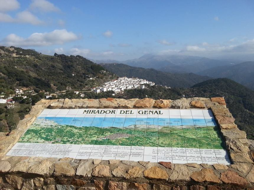 A mural shows the mountain peaks of the Genal Valley. In the background, one of the countless white villages of Andalusia