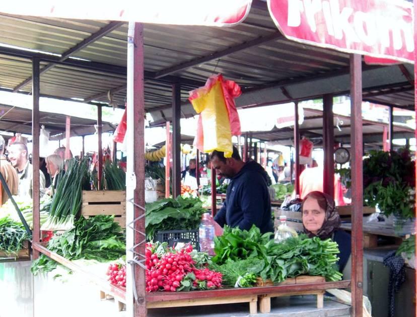 An elderly woman awaits a customer in Belgrade's open air market.