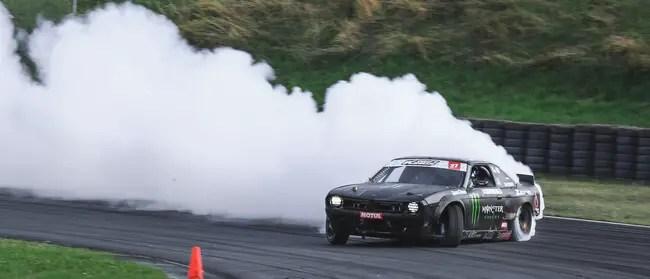 Car drifting leaving a long trail of white smoke