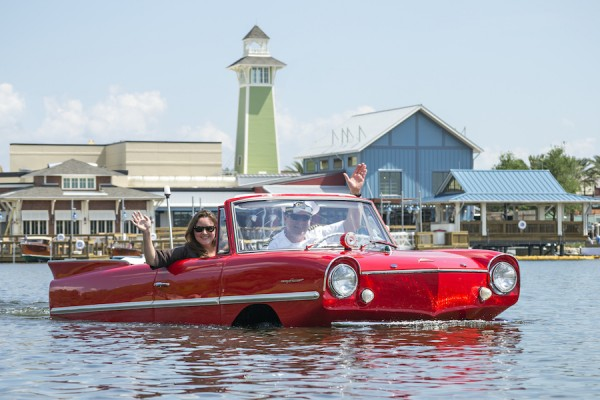 Red classic car in water at Disney Springs Boathouse.