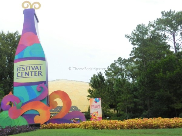 Festival Center at Epcot with purple, blue, and pink giant wine bottle for Food and Wine Festival