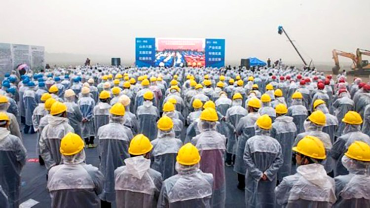 Workers-Watch-Ground-Breaking-Ceremony