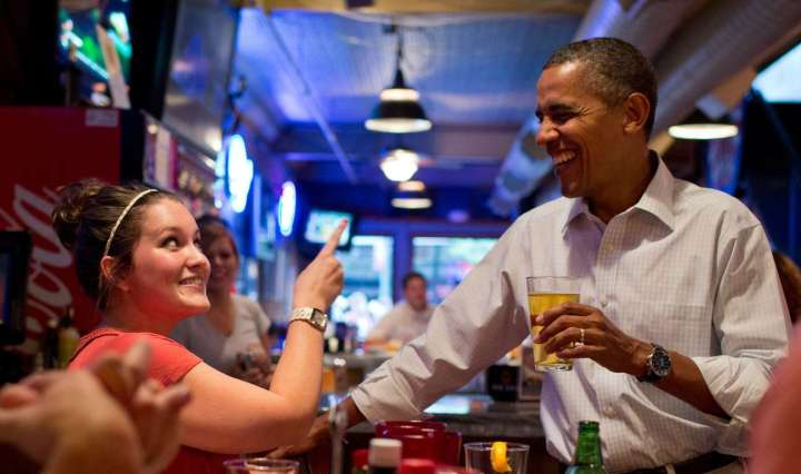 President Barack Obama has a beer with patrons at the Pump Haus Pub and Grill in Waterloo, Iowa, Aug. 14, 2012.