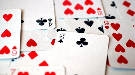 A deck of playing cards laid out in random order (Flickr: incurable_hippie)