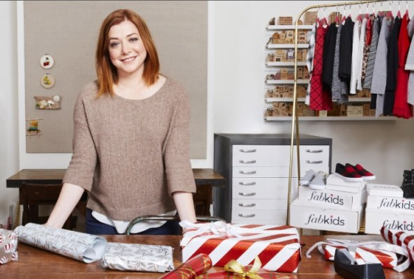 Alyson Hannigan and family graciously turned their home into Santa's workshop to package FabKids shirts, pants, dresses, hats, and accessories to donate to children through Corazon de Vida. (PRNewsFoto/FabKids)