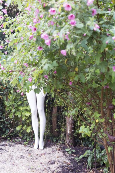 A shop mannequin used as garden statuary