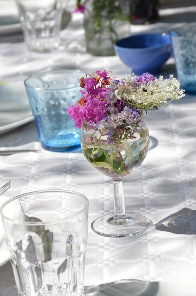 Use wine glasses for flowers.