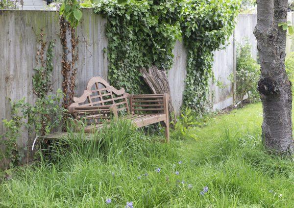Lutyens bench in a long thin town garden