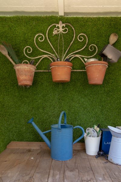 Organise the shed by using terracotta and tin pots to store smaller items