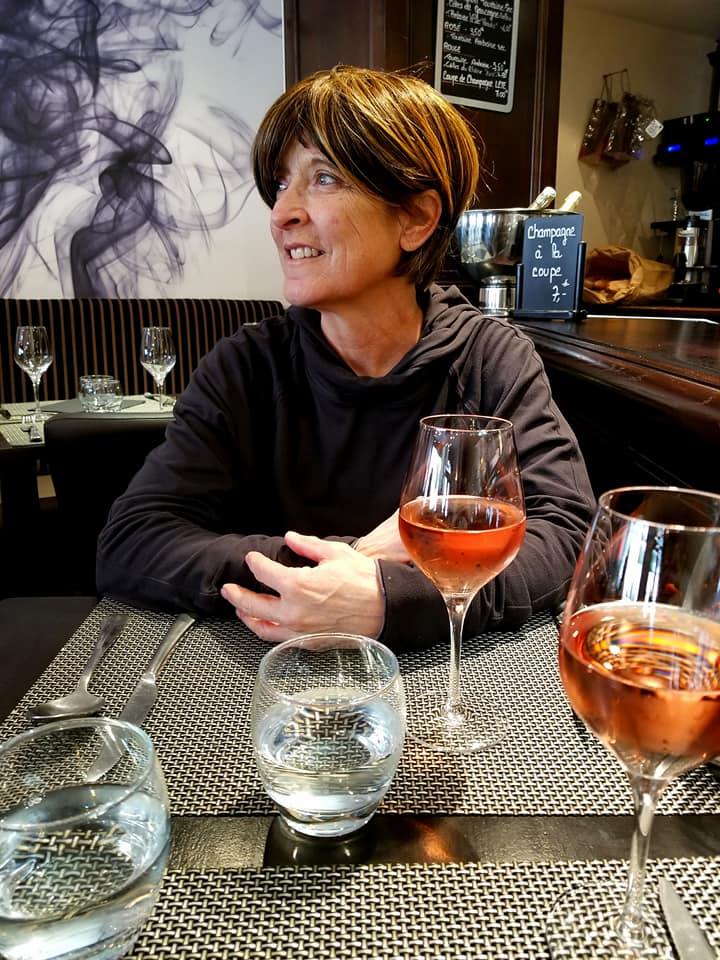Woman drinking rose in a French restaurant in Amboise.