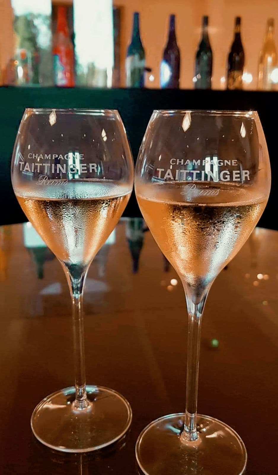 Two glasses of Taittinger champagne at a champagne tour in Reims.