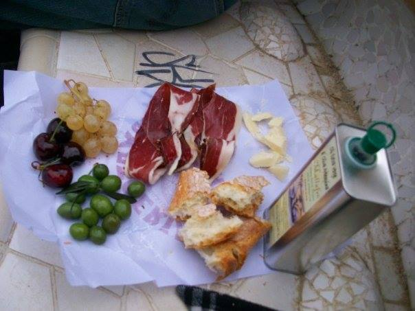 Picnic in Barcelona - bread, cheese, olives, grapes, jamon, olive oil.