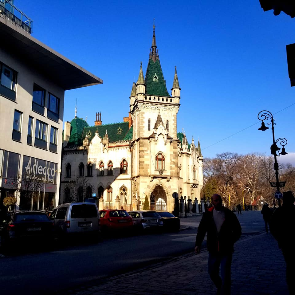 Jakab's Palace in Kosice, Slovakia. It is rather small for a 'palace,' but it is beautiful cream colored building with an emerald green roof and large spires.