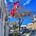British and Bermudian flags hanging outside of King's Square in St. George's, Bermuda.