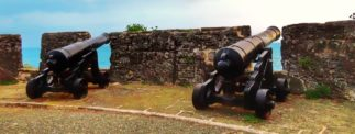 Two cannons, pictured from behind, looking out over the Atlantic in St. George's, Bermuda - located at Gates Fort