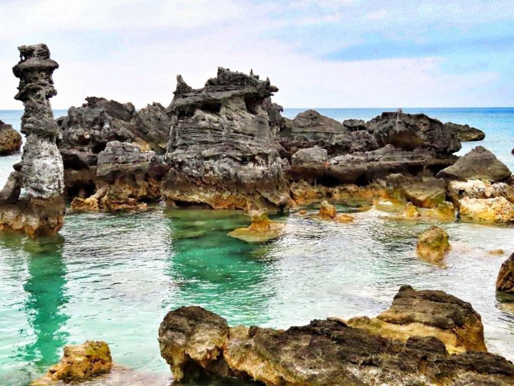 Jutting rock formations coming out of the water at Tobacco Bay in St. George's, Bermuda