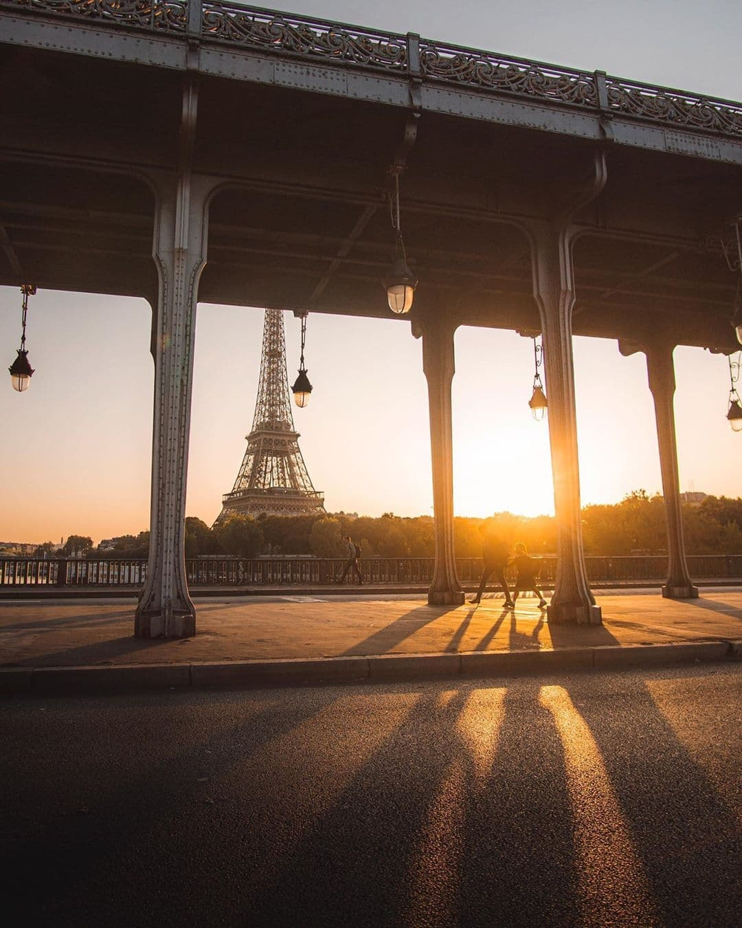 View of the Eiffel Tower from Pont Bir-Hakeim during golden hour