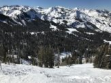 Snow covered alpine forest and mountains outside of Salt Lake City, Utah - one of the most underrated US cities.
