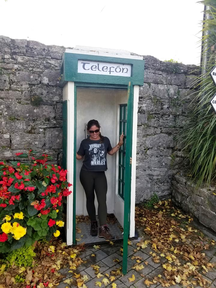 Woman in phone booth in Ireland