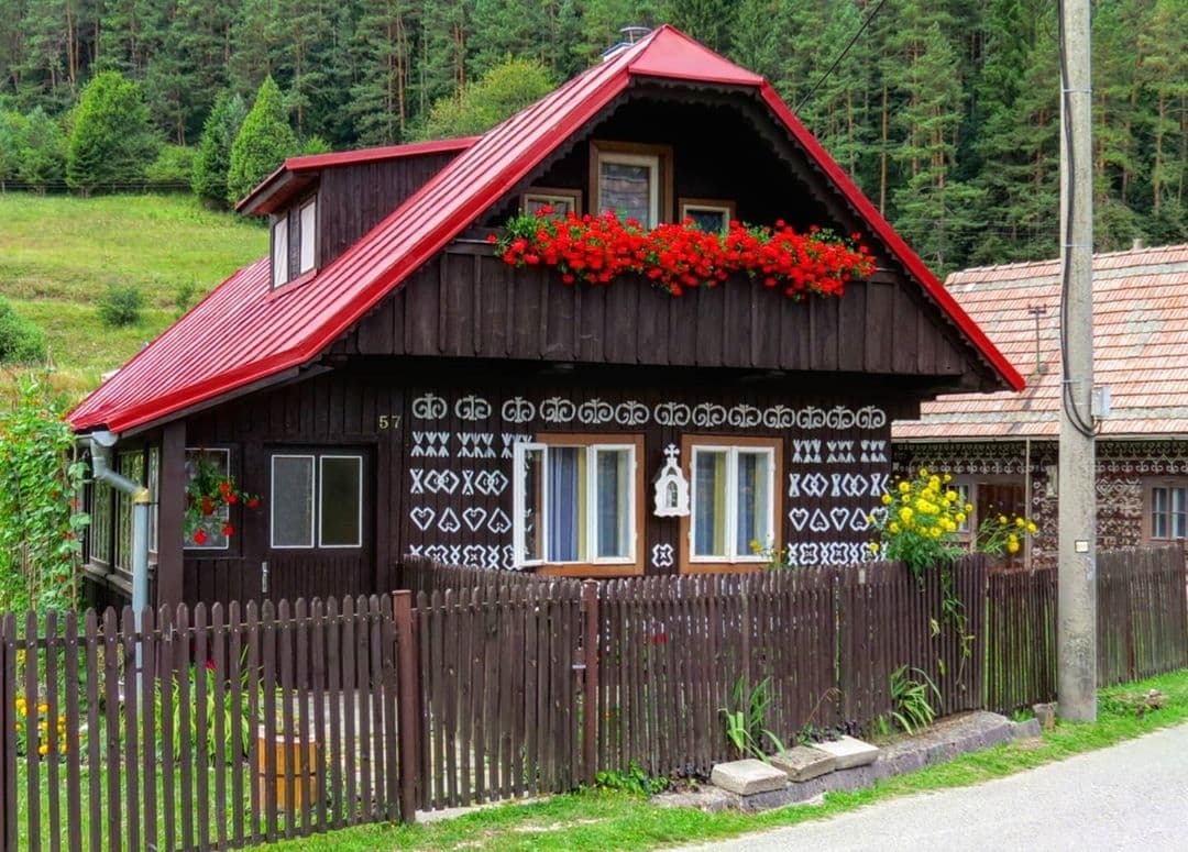 Slovakia painted building with red roof and flowers