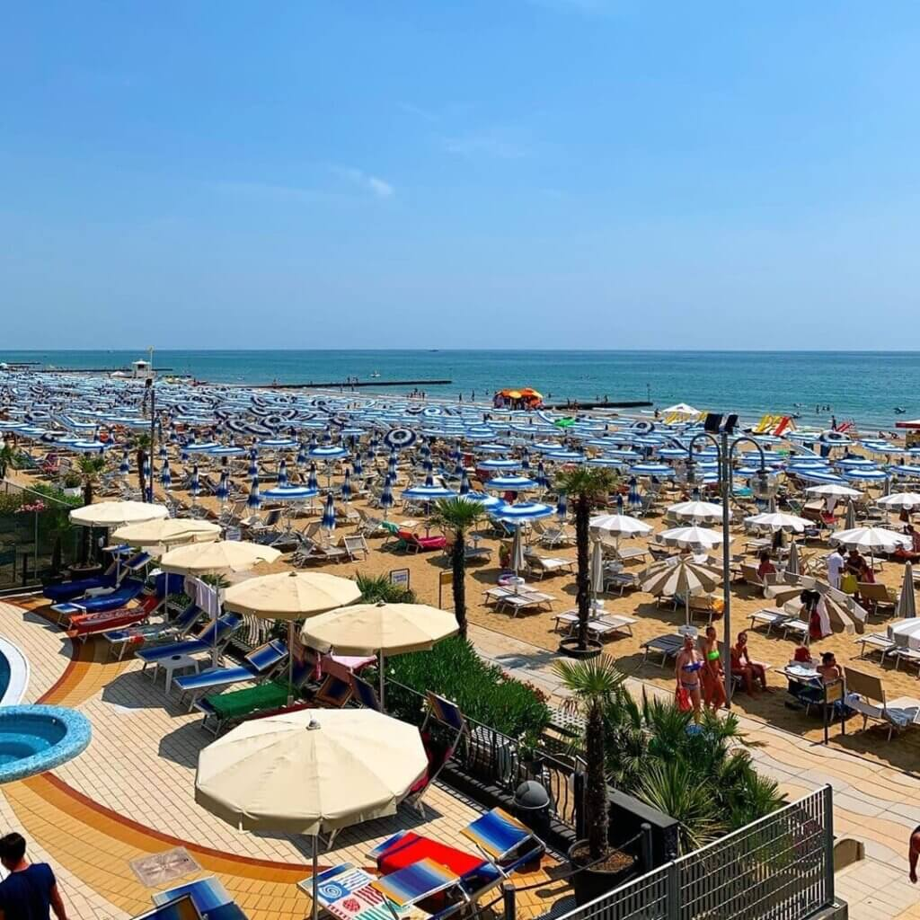 View from upper deck of the sun chairs on Lido di Jesolo in Italy, an underrated beach destination in Europe.