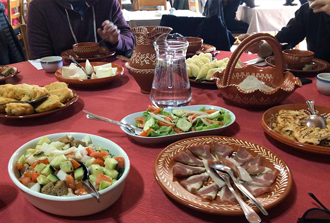Assorted Portuguese dishes on a table spread out.