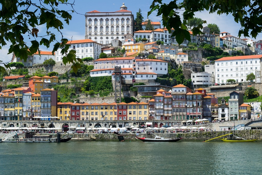 Porto Ribiera district seen from across the river through some leaves.